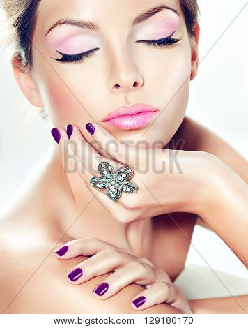 Beautiful girl model demonstrates pure beauty . Well-groomed ,clean skin, purple n manicure and the nails and the ring on his finger.
