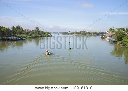 HOI AN, VIETNAM - JANUARY 04, 2016: The Thu Bon river in the early morning Hoi An. Tourists in the morning floating on the river Thu Bon. Tourist  landmark of theVietnam