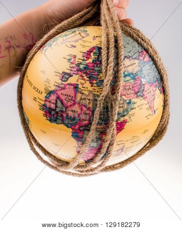 globe hanging in rope on white background