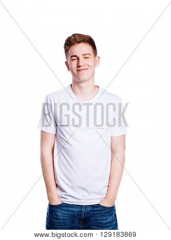Teenage boy in jeans and white t-shirt, young man, studio shot on white background