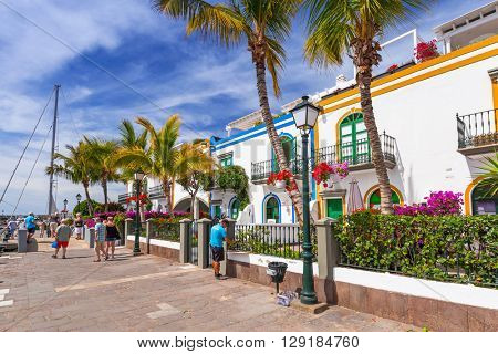 PUERTO DE MOGAN, GRAN CANARIA, SPAIN - APRIL 21, 2016: Pedestrian alley in the harbor area of Puerto de Mogan, a small fishing port on Gran Canaria, Spain. It's called a Little Venice of the Canaries.