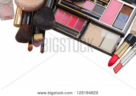 make up products with lipsticks and  and brushes border isolated on white background