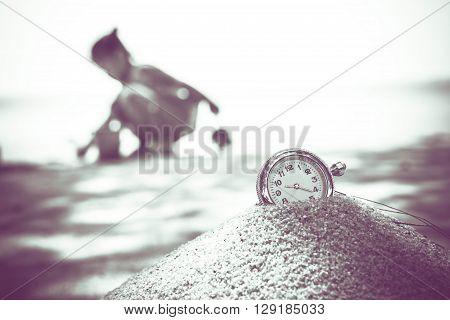 vintage pocket watch on sand. Vintage Stule.