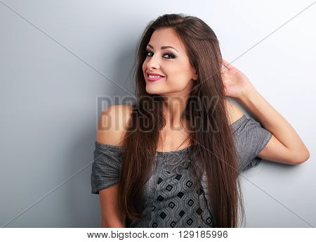 Thinking Makeup Beautiful Female Model Relaxing And Looking On Blue Background