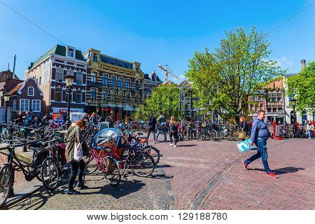 Utrecht Netherlands - April 20 2016: street scene in the old town with unidentified people. The university city Utrecht is the 4th largest city of Netherlands and capital of the same named province