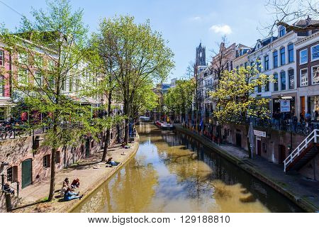 Utrecht Netherlands - April 20 2016: old town scene at a canal in Utrecht. The university city Utrecht is the 4th largest city of the Netherlands and capital of the same named province