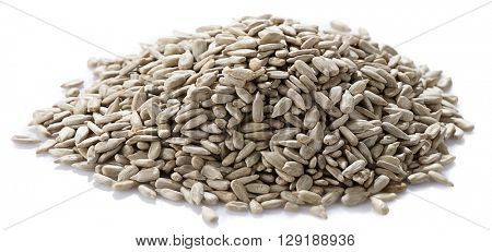 Heap of fresh sunflower seeds isolated on white background.