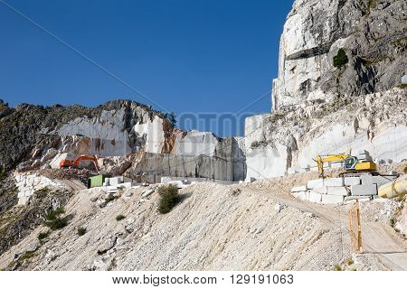 Marble Mine - Working marble mine in the Italian Alps near Carrara in Tuscany in Italy. Carrara marble is widely recognized for its superior quality.