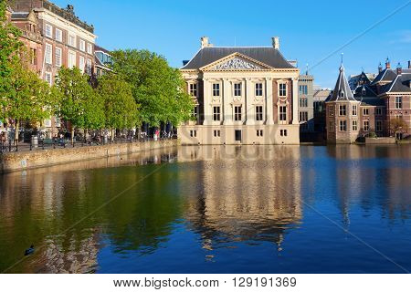 The Hague Netherlands - April 20 2016: Mauritshuis in The Hague with unidentified people. It is an art museum that houses the Royal Cabinet of Paintings with mostly Dutch Golden Age paintings