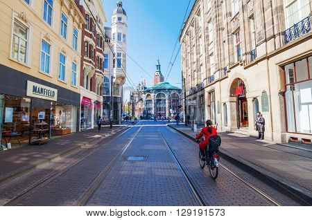 The Hague Netherlands - April 21 2016: city street in The Hague Netherlands with unidentified people. The Hague is the seat of the Dutch government and the 3rd largest city of the Netherlands