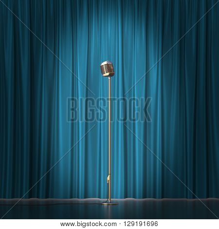 Retro gold microphone on blue cloth background.