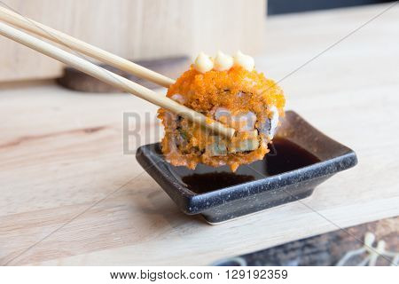 Sushi California rolls dipping sauce with chopsticks Japanese food concept