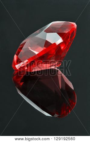 red ruby with reflection on dark background