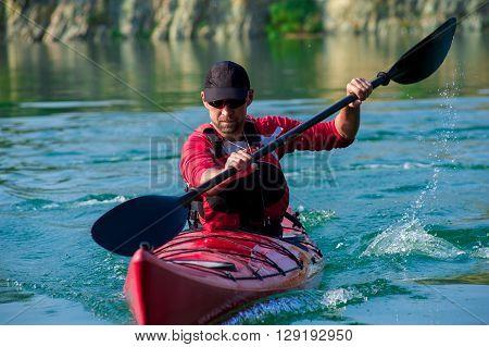 Man Kayaking On The River Sunset01