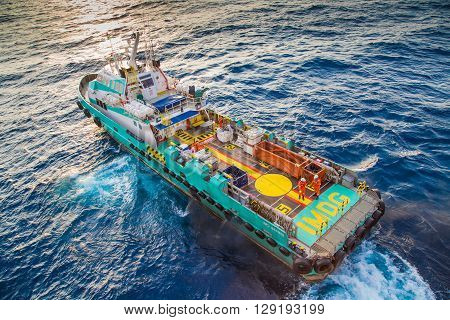 crew boat receive and transfer passenger to oil and gas processing platform and loading cargo