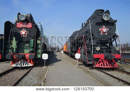 SAINT PETERSBURG, RUSSIA - MARCH 30, 2016: Vintage steam locomotive P36 and LB18 are on the October railway. Historical landmark of the city Saint Petersburg