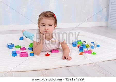 Happy ?hild girl playing with toys constructor