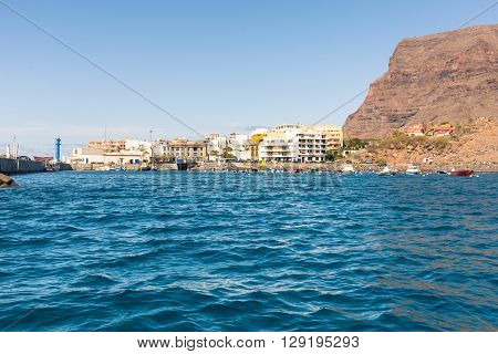 Incoming from sea, reaching the port of the Valle Gran Rey in the small town Vueltas on the Canary Islands offers a fantastic view to the mountains around the valley. Many boats in the harbor