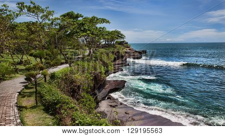 Coast at Uluwatu temple, Bali, Indonesia. The path by the ocean