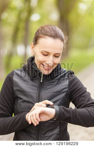 Young Woman Use Fitness Smart Watch After Jogging