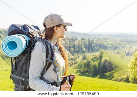 Young Smiling Woman Traveling With Backpack