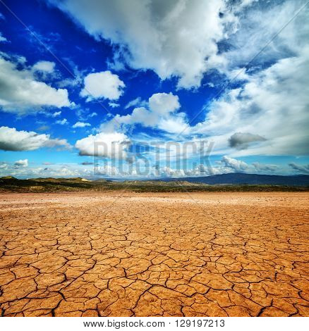 Cracked ground and cloudy scay. Natural disaster landscape