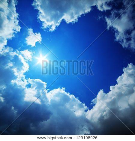 Blue sky, sun and clouds