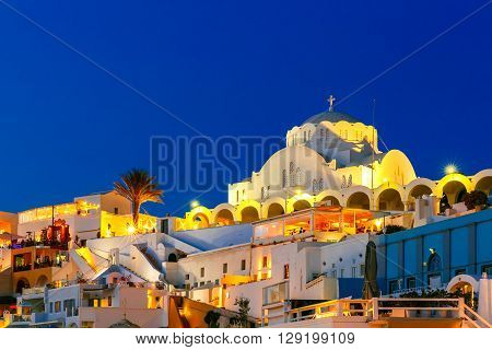 Orthodox Metropolitan Cathedral of Fira, modern capital of the Greek Aegean island, Santorini, during twilight blue hour, Greece