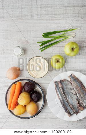Ingredients for a classic herring with vegetables vertical