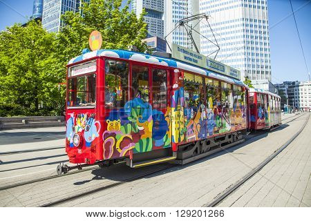 FRANKFURT GERMANY - MAY 8 2016: people enjoy the ride with the Ebbelwei express in Frankfurt Germany The Ebbelwei-Express is a touristic line established in 1977.