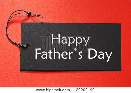 Happy Fathers Day Text On A Black Tag