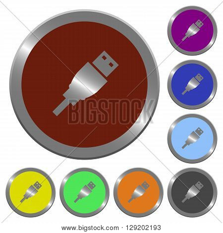 Set of color glossy coin-like USB plug buttons.