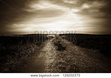 dark, moody, road leading into the future in the distance