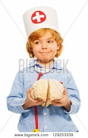 Cute boy playing doctor with toy human cerebrum, isolated on white