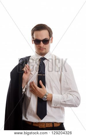 Fancy dressed man holding his jacket over his shoulder