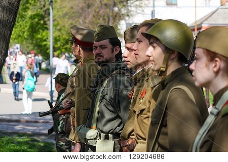 ULYANOVSK, RUSSIA - MAY 9, 2016: People take part in reconstruction of soviet military uniform at the Immortal regiment on 9 May, 2016 in Ulyanovsk, Russia