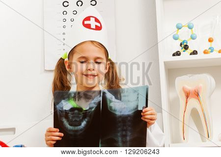 Young dentist studying a skull x-ray at the doctor's office