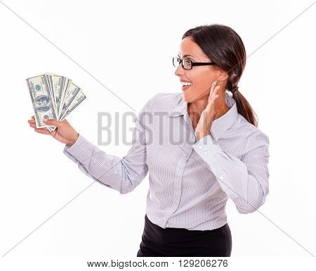 Impressed Brunette Woman Holding Dollar Bills