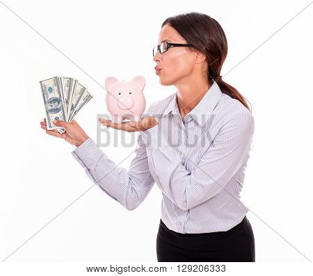 Businesswoman Showing Piggy Bank And Dollar Bills