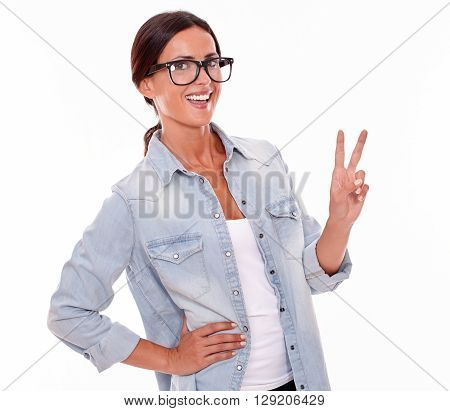 Excited Brunette Woman Showing Victory Sign