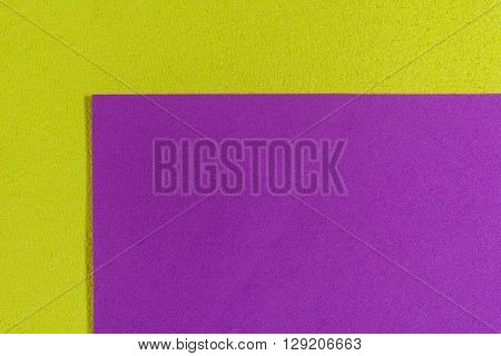 Eva foam ethylene vinyl acetate smooth pink surface on lemon yellow sponge plush background