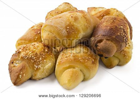 Fresh Serbian pastry rolls with cheese and sesame, kifla, kiflice, isolated on white background