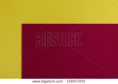 Eva foam ethylene vinyl acetate sponge plush red surface on lemon yellow smooth background