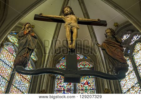 Cologne, Germany - May 16: It is an ancient wooden crucifix is located in one of the niches of the Cologne Cathedral May 16, 2013 in Cologne, Germany.