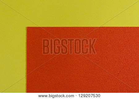 Eva foam ethylene vinyl acetate sponge plush orange surface on lemon yellow smooth background
