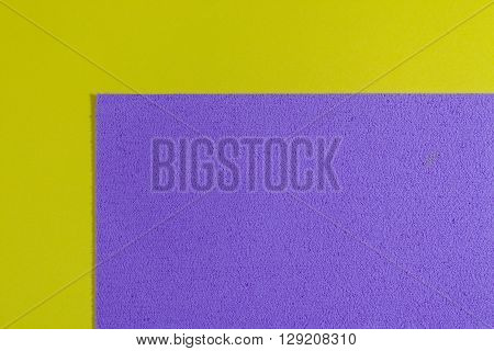 Eva foam ethylene vinyl acetate sponge plush light purple surface on lemon yellow smooth background
