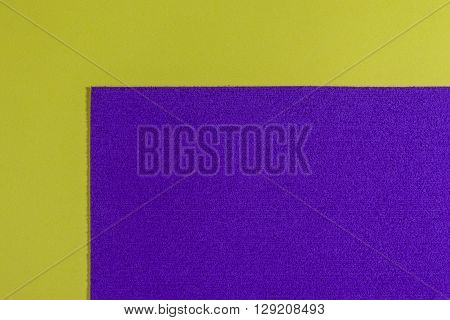 Eva foam ethylene vinyl acetate sponge plush purple surface on lemon yellow smooth background