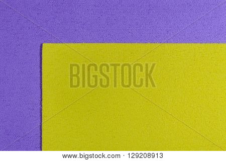 Eva foam ethylene vinyl acetate lemon yellow surface on light purple sponge plush background