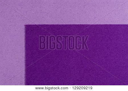 Eva foam ethylene vinyl acetate purple surface on light purple sponge plush background