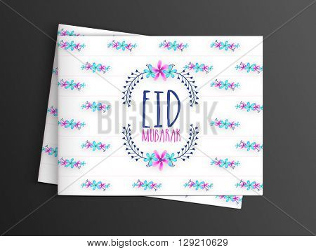 Colourful flowers decorated beautiful greeting card design with for Muslim Community Festival, Eid Mubarak celebration.